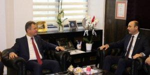 Talip Geylan, ÖSYM Başkanı Prof. Dr. Halis Aygün'ü ziyaret etti